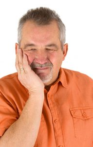 man suffering from TMJ
